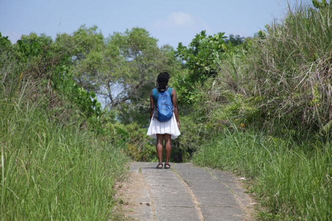 Campuhan Ridge Walk in Ubud. Sustainable Travel Tip: She's carrying a refillable water bottle in the side of her bag.